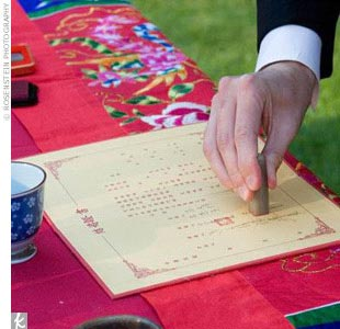 Kimberly, Jason, and their parents signed a red Chinese wedding contract with seals and special red ink, made for the couple in Taiwan. Kimberly's sister emceed the event and provided explanation for all their guests.
