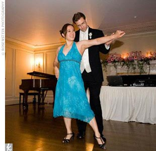 "Kimberly and Jason had taken Argentinean tango lessons to dance their first dance to ""Jalousie"" by Jacob Gade. Kimberly also changed into her fourth dress for this performance -- a turquoise blue, Empire-waist, knee-length, halter dress with black ballroom dancing heels."