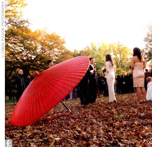 Susan and Simon's simple ceremony took place on Cherry Hill in Central Park. Guests stood and formed a horseshoe shape around the couple as they said their vows. The only addition to the scenery was a large red parasol, which blended nicely with the fall leaves.