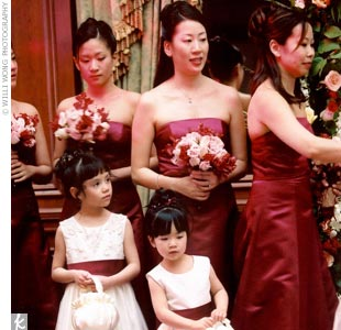 Angie's six maids wore strapless, custom-made, floor-length, dresses in raspberry red. They carried bouquets of small pink roses and crimson orchids.