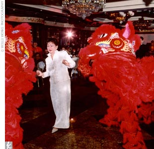 "While Angie and Ivan's guests decided among 11 different entree options, Chinese lions danced their way into the room to the sounds of drums. ""It was amazing to watch the lion dancers perform acrobatic jumps in an elegant ballroom,"" says Angie."