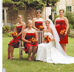 Mandy's four bridesmaids wore simple strapless merlot tea-length dresses by Bill Levkoff. The bride replaced the black velvet ribbon belts with burgundy ones that had a hint of orange to better fit the color palette. The bridesmaids also wore burgundy crystal chandelier earrings and bracelets that Mandy had given them as gifts.