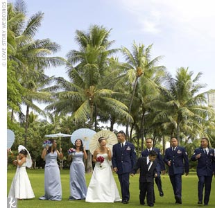 The bridesmaids wore two-piece, cornflower blue, halter gowns designed by Alfred Angelo. The maid of honor wore a similar dress with a spaghetti-strap neckline and a slim, A-line, floor-length skirt. A family friend created the blue Swarovski crystal bracelets and matching earrings for the attendants to wear.