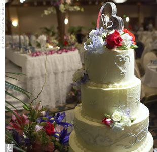 A five-tiered wedding cake was the highlight of the dessert table, with the bottom tier featuring white cake with guava mousse, and the top layer a chocolate cake with vanilla mousse. Each tier of the buttercream-frosted confection had a baby-blue piping design, and a scattered arrangement of blossoms to match the wedding flowers.