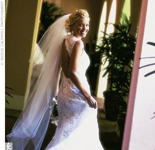 The bride wore a fitted alençon lace gown with a sweetheart neckline and open back.