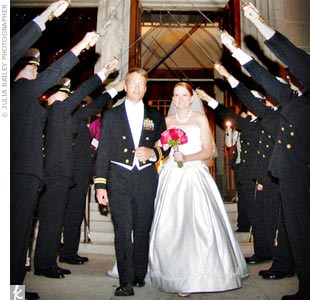 Trey, an aviator in the Navy, wore his formal mess dress uniform with white tie. His five groomsmen and four ushers wore standard tuxes from Perlis, and after the ceremony, the couple exited the grand Catholic cathedral under a formal military arch of sabers.