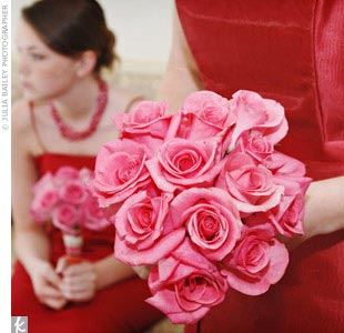 """Because I love a good creative challenge, I ordered 250 roses in six different shades of pink and red from a wholesale florist,"" Joellynn explains. With help from friends and family, she created a different-colored bouquet for each bridesmaid, a bouquet for herself that combined all six shades, plus boutonnieres, several large centerpieces, and sm ..."
