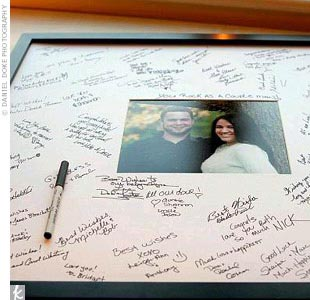 "Instead of a traditional guest book, Shayna and Marc's guests signed the oversized mat around one of their engagement photos. ""I loved this idea when I saw it,"" Shayna says. ""I plan to hang it on the wall for years of memories."""