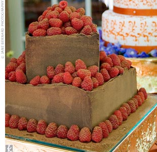 The groom's cake was chocolate with layers of raspberry preserves in the middle, served with fresh raspberries and raspberry sauce.