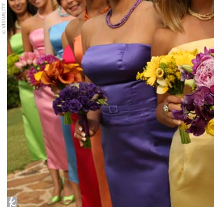 "All seven maids wore the same slim-fitting strapless dress by Mackenzie Michaels in different colors. ""I chose the colors based on what looked best on each girl and their personality,"" Kelli explains. Each maid also sported a pair of peep-toe heels, dyed to match her dress."