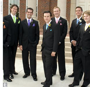 Tre and his seven groomsmen wore black, three-button tuxedos with simple black vests -- though Kelli didn't abandon her color scheme on the guys. Each groomsmen accessorized with a tie and pocket square made from the same fabric as the bridesmaid dresses. Tre's accessories were turquoise satin and matched Kelli's sash perfectly.