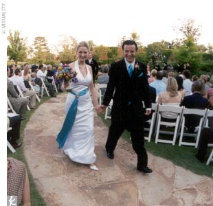 "Kelli and Tre married on a flagstone platform in a blooming garden near a stream. With the help of her brother, Kelli wrote the entire ceremony, which was performed by a family friend. ""We wanted the ceremony to be personal,"" Kelli says. ""It was very special."""