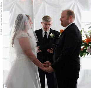 It had rained that morning and although the rain stopped just beforehand, the ceremony was moved inside to the tent. Rebecca and Daniel's ceremony was a personal one: Rebecca's father officiated, a close friend did a reading, and the couple exchanged vows that they had written themselves.