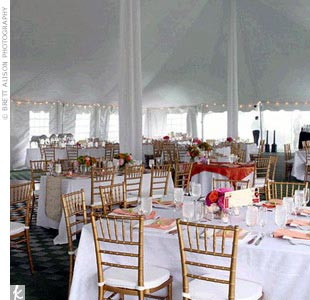 Rebecca and Daniels reception tent was set with square tables and gold chiavari chairs for an elegant airy look. Small white lights outlined the walled tent and an extensive buffet line was set up near the middle.