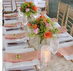 The oceanside white tent was set for Rebecca and Daniel's 125 guests. Each table included a menu -- handmade by the bride -- candles, and lush floral centerpieces.