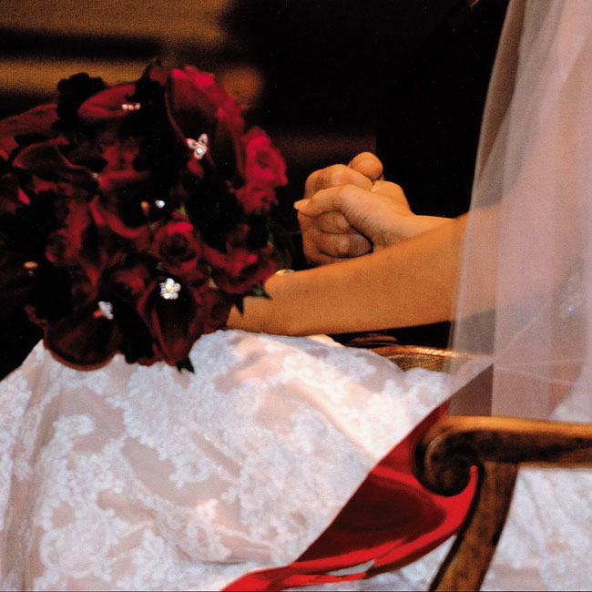 Bridget and her bridesmaids carried bouquets of crimson mini calla lilies sparkling with crystals.