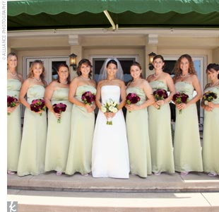 "Lisa's bridesmaids wore strapless, matte satin, A-line dresses with banded trim from The Dessy Collection by After Six. ""We chose a light green color to complement the outdoor garden feel of the wedding and the green and white house,"" says Lisa. ""It kept everything looking fresh and cool."""