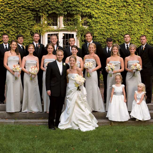 Sarah's seven bridesmaids wore A-line, spaghetti strap dresses in desert clay satin by Vera Wang.