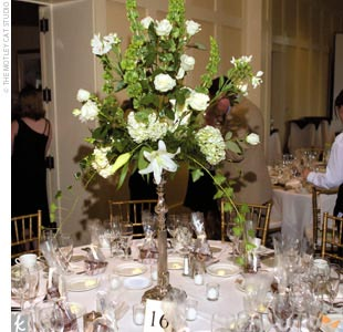 The ceremony and reception flowers were ivory roses, lilies, and hydrangeas.
