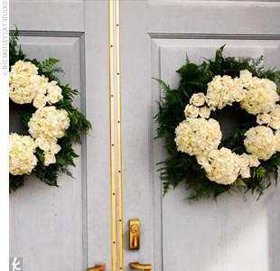 The ceremony decor included fresh wreaths of hydrangeas and greenery for the church doors.