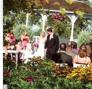 Tricia and Chads ceremony took place at a picturesque gazebo in a lakeside flower garden, which created the perfect wedding backdrop -- no decorating required!