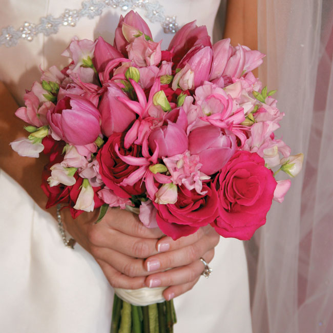 The bridal bouquet held a mix of Sumatra lilies, tulips, roses, Nerine lilies, kiko, sweet peas, and Mysteen orchids.
