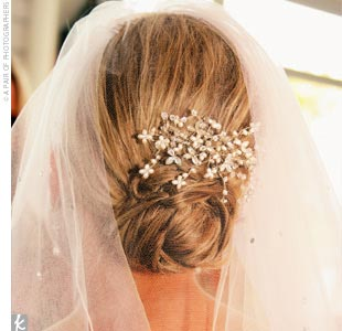 The bride wore a gorgeous custom-made hairpiece of Swarovski crystals, pearls, and zirconia in a natural shape resembling blossoming branches.