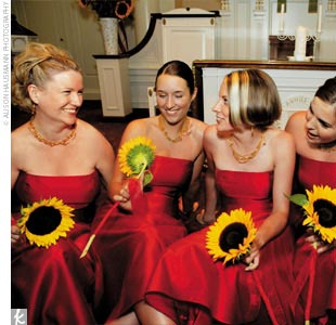 Tassia's bridesmaids wore strapless, deep red satin, tea-length dresses. A family friend, Jane Checkeye, made the dresses.