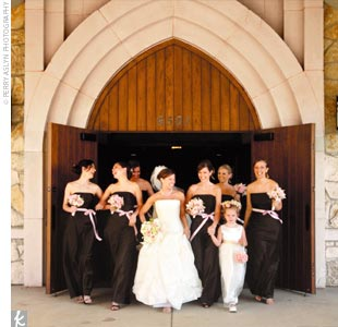 Shalene's bridesmaids wore chocolate-brown floor-length dresses. Shalene wore a strapless, ivory gown with a pick-up skirt featuring pale pink and pearl appliques.