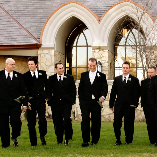 BJ wore a black three-button double-breasted tuxedo with an ivory vest and ivory tie, while the six groomsmen wore the same tuxedo with a black vest and tie.