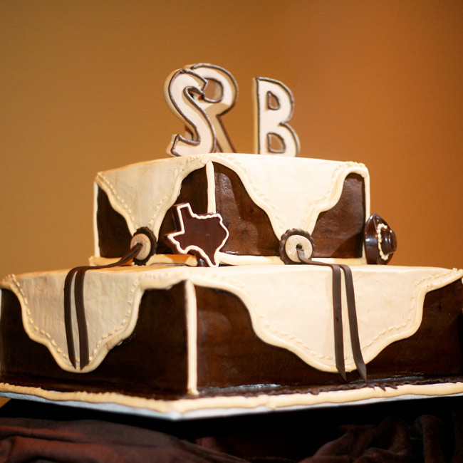 The groom's cake was a three-tiered square all-chocolate cake, with the icing fashioned to look like Western-style designs pressed in leather. The cake was also bedecked with cowboy hat and football-shape chocolates.
