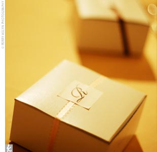 At each place setting, guests found boxes with monogrammed, frosted cookies inside.