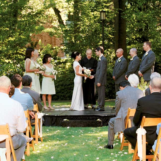Dori and Ian recited their vows under the shade of a canopy of trees in the secluded Grieg Garden on the University of Washington campus.