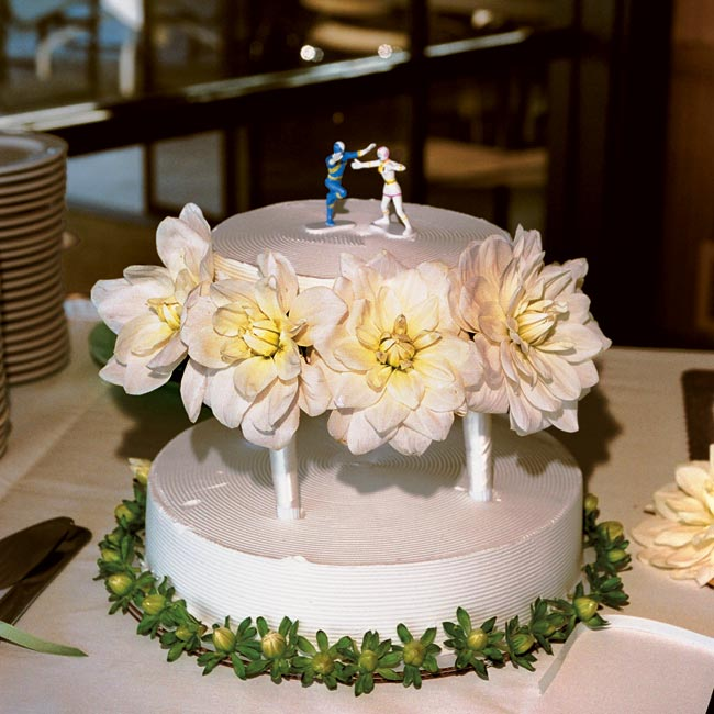 To please all of their guests' taste buds and dietary needs, the couple had two cakes. One was a two-tier, Chinese sponge cake with whipped cream frosting for display plus two sheet cakes for cutting; the other was a round, sugar-free carrot cake.