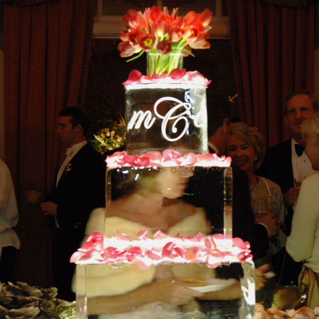 The dining room boasted a three-foot ice sculpture of a wedding cake, punctuated with the couple's monogram and scattered with rose petals.