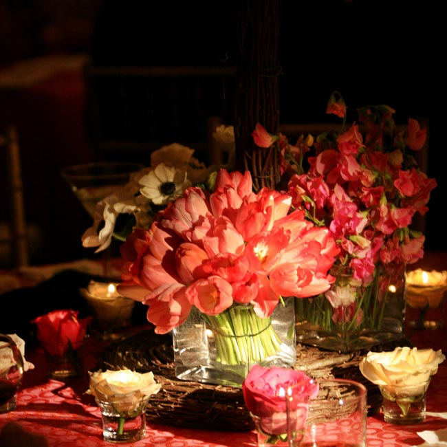 Tables draped with raspberry linens stood at one end of the ballroom and were topped with birch twigs, pink and white tulips, roses, lilies, and bells of Ireland.