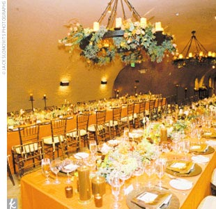 At the reception, each table was topped with low centerpieces that included mango calla lilies, grapes, Ecuadorian roses, and hydrangeas. Each centerpiece was surrounded by votive candles.