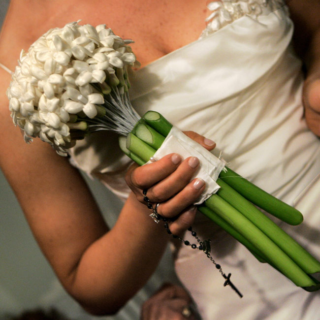 Renee carried stephanotis bound with white ribbon, while her bridesmaids carried honey- and caramel-colored roses. The groomsmen wore white denbrobium boutonnieres.