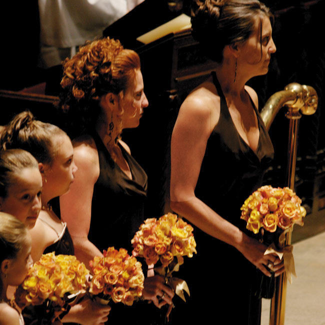 Renee's bridesmaids wore satin, floor-length halter dresses in chocolate brown by Jim Hjelm. Her junior bridesmaids dressed similarly in spaghetti-strap dresses of the same color.