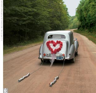 Ashley and her mother traveled to the ceremony in a 1951 Bentley, and the bride and groom left in the same retro vehicle for the reception.