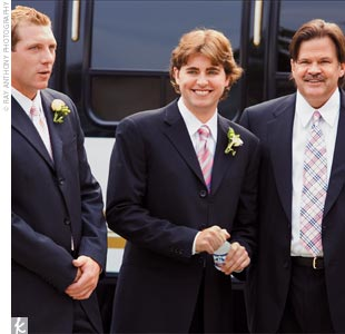 The groom and groomsmen were dashing in dark suits with striped Burberry ties.