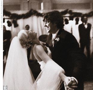 "You'd never know from the photographs of their wedding day that any part of the planning went in an unexpected direction. ""Our favorite photo is one that captured Cory and me during our first dance. He is dipping me and smiling -- it's gorgeous,"" says Merideth. ""I relive the moment every time I look at it."""
