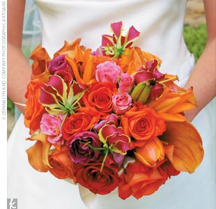 Katy's bouquet featured a vibrant mix of orange, pink, and red flowers.