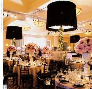 "The ballroom was decorated in a modern interpretation of the couple's palette: pink lamour table linens; bone white urns filled with hydrangeas; black-and-white floral silhouettes; towering black lampshades; and white fur and pink satin banquettes that edged the hand-painted dance floor complete with the ""B"" monogram."
