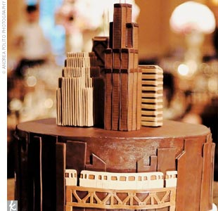 The groom's cake paid tribute to the couple's current hometown of Chicago. The mirror-top table was etched with a map of Chicago, with the cake rising up to create a chocolate-sculpted version of the skyline.