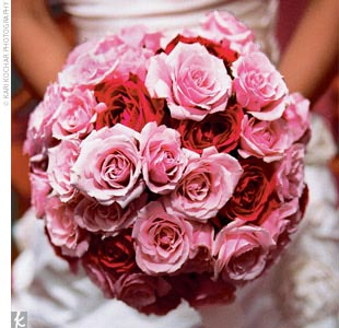 Rose carried a bouquet of roses in different sizes and shades of pink.
