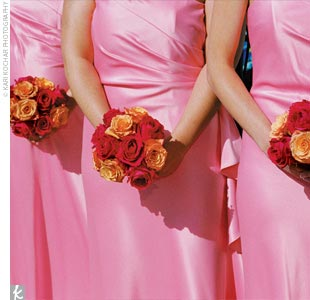 The six bridesmaids wore strapless coral-colored satin gowns and gold-filled citrine drop necklaces, which were a gift from the bride.