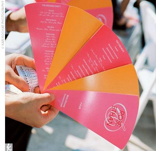 They created programs that doubled as fans to keep their guests cool during the outdoor ceremony, with each fan blade alternating between pink and orange.