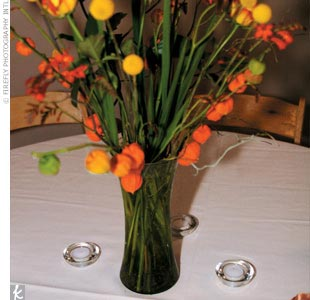 To add to the spectacular atmosphere, the couple outfitted the room with an eclectic mix of flowers, including green cymbidium orchids and bright orange Chinese lanterns, from her parent's wholesale shop in Mount Vernon.