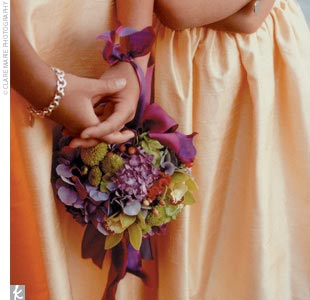 The junior bridesmaids carried pomanders, which tied around their wrists.